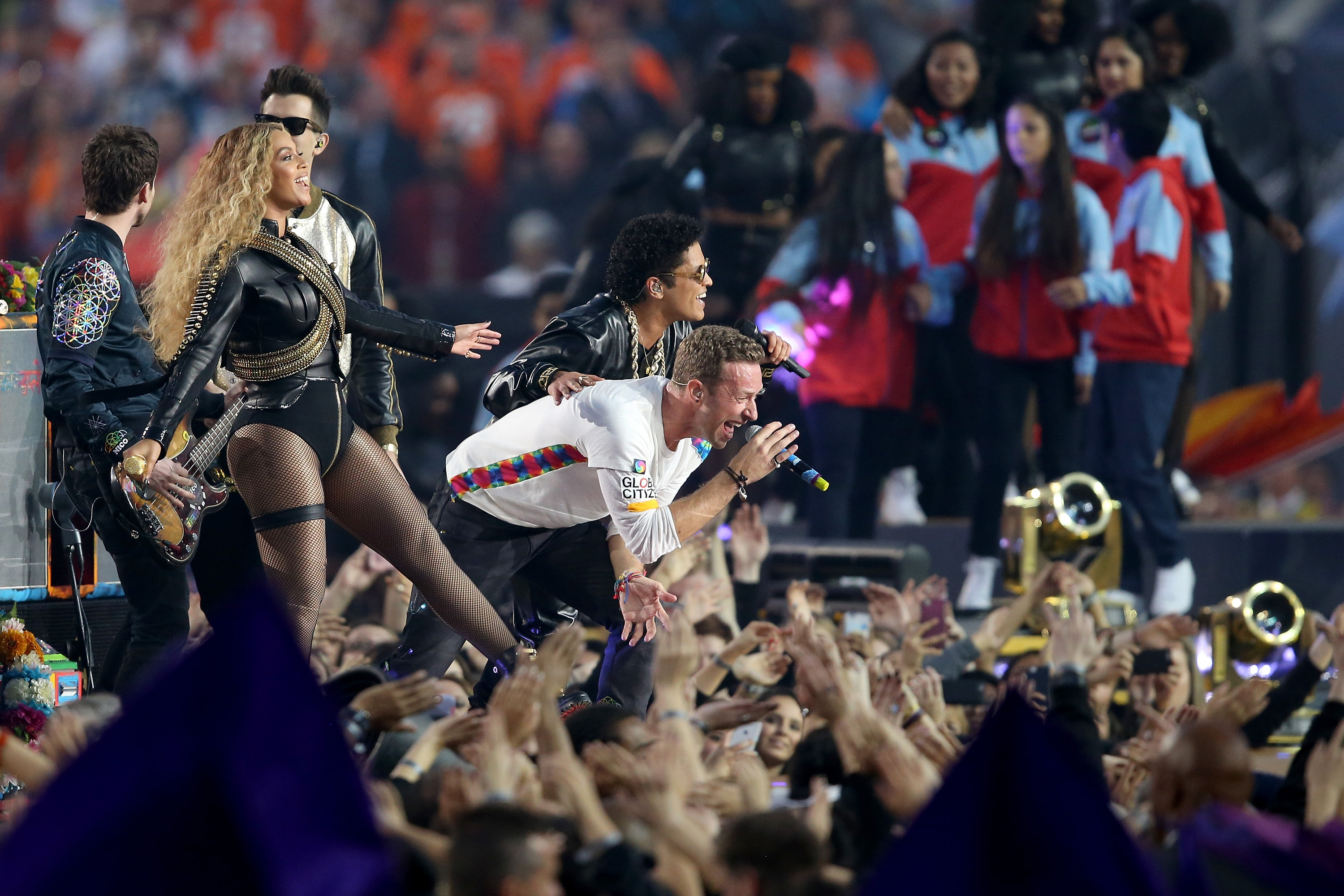 SANTA CLARA, CA - FEBRUARY 07: (L-R) Beyonce, Chris Martin of Coldplay, and Bruno Mars perform during the Pepsi Super Bowl 50 Halftime Show at Levi's Stadium on February 7, 2016 in Santa Clara, California. (Photo by Andy Lyons/Getty Images)
