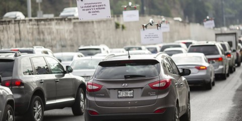 Uber Technologies Inc. drones advertise uberPOOL above traffic on a highway in Mexico City, Mexico, on Friday, June 17, 2016.