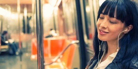 woman-listening-to-audiobook-on-train