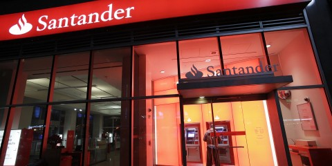 A branch of Santander bank is shown, Tuesday, Dec. 17, 2013 in New York.  (AP Photo/Mark Lennihan)