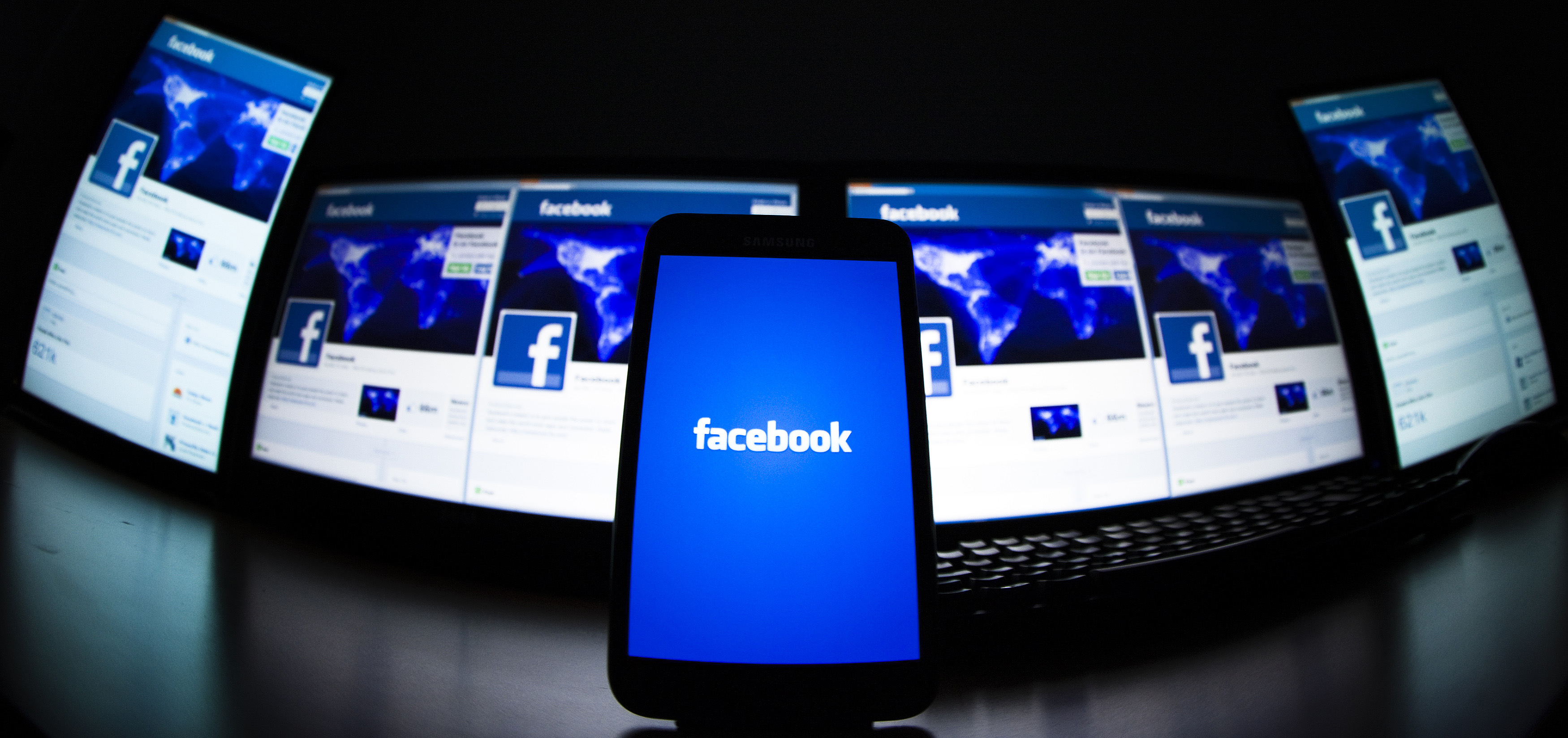 The loading screen of the Facebook application on a mobile phone is seen in this photo illustration taken in Lavigny May 16, 2012. Facebook Inc increased the size of its initial public offering by almost 25 percent, and could raise as much as $16 billion as strong investor demand for a share of the No.1 social network trumps debate about its long-term potential to make money. Facebook, founded eight years ago by Mark Zuckerberg in a Harvard dorm room, said on Wednesday it will add about 84 million shares to its IPO, floating about 421 million shares in an offering expected to be priced on Thursday. REUTERS/Valentin Flauraud (SWITZERLAND - Tags: BUSINESS SCIENCE TECHNOLOGY SOCIETY TPX IMAGES OF THE DAY) - RTR325LC